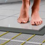 Как сделать электрический теплый пол под плитку в ванной своими руками